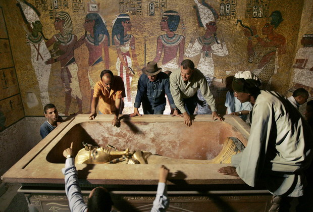 Hawass, head of High Council for Antiquities, supervises removal of the mummy of Tutankhamen from his stone sarcophagus in Valley of the Kings in Luxor